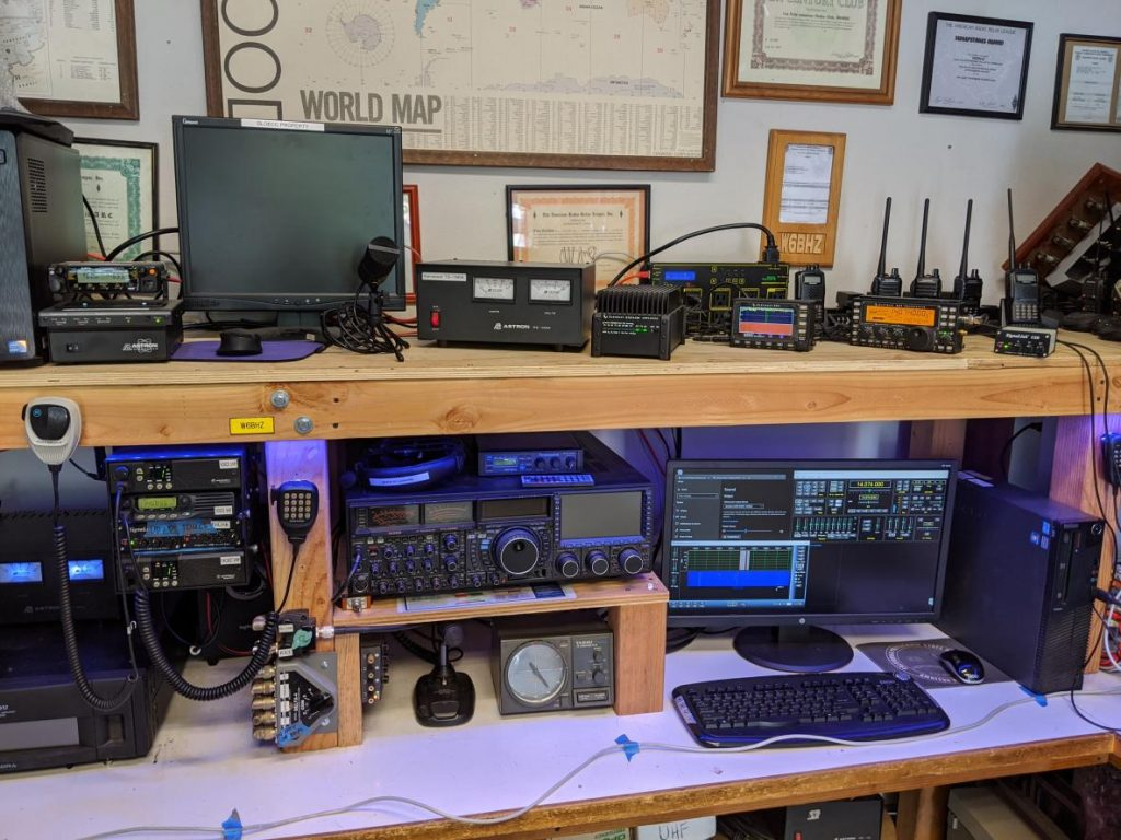 HF Station including an Elecraft KX3 for remote operations and Yaesu FTDX9000 for in-person operations. Desktop in lower right runs software for remote HF operations.